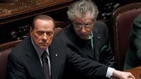 Outgoing Italian Prime Minister Silvio Berlusconi and former ally Umberto Bossi in parliament (Reuters)