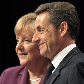 French President Nicolas Sarkozy and German Chancellor Angela Merkel disagree over the ECB's role (Reuters)
