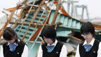 A minute's silence for the victims Ishinomaki (Reuters)