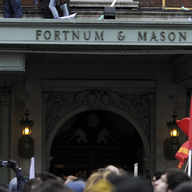 Demonstrators from UK Uncut protest at Fortnum and Mason. Ten have been found guilty of aggravated trespass (Reuters)