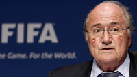 Fifa President Sepp Blatter apologises for his comments on racism in football, saying they were