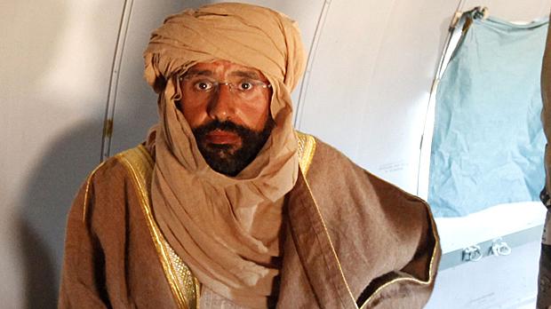 Saif Gaddafi captured in the Libyan desert (Image: Reuters)