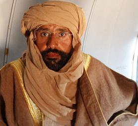Saif Gaddafi on the plane (Image: Reuters)