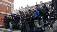 Press photographers wait outside the Leveson inquiry at the Royal Courts of Justice (Reuters)
