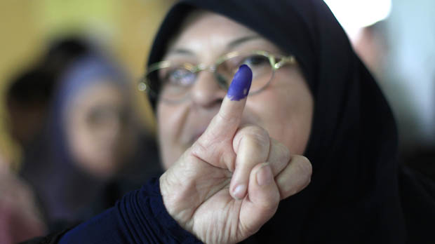 Egyptian woman casts vote in Egypt's elections (Reuters)