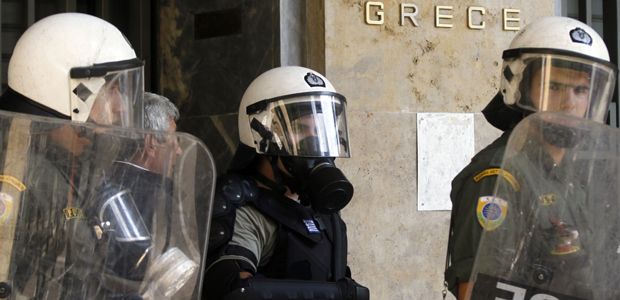 Riot policemen stand guard outside Greece's central bank during a 24-hour general strike in Athens, Greece on 5 October 2011 (Getty)