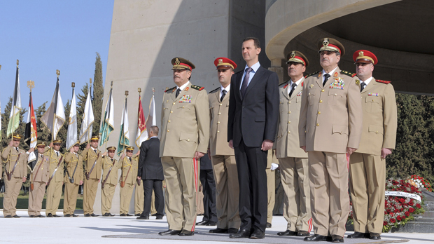 President Assad with military leaders at a ceremony in Damascus