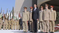 President Assad with army leaders at a ceremony in Damascus on Thursday (Reuters)