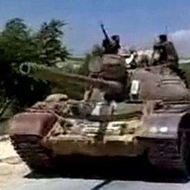 Military tanks drive into the Jabal Al-Zawya area of Idlib (Reuters)