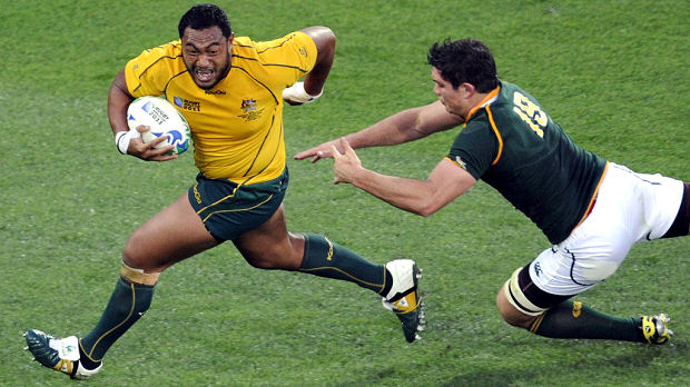 Australia put defending champions South Africa out of the Rugby World Cup, defeating them 11-9 in Wellington. In the other quarter-final, New Zealand overpowered Argentina 33-10. (Reuters)