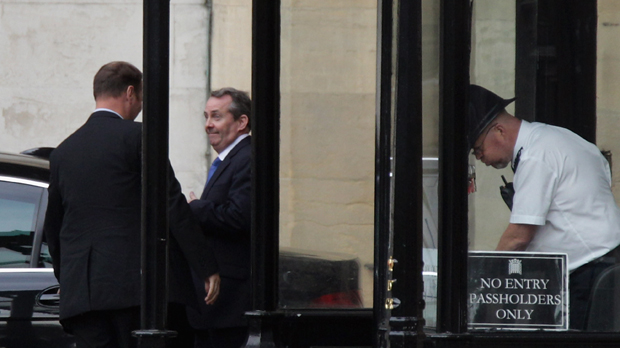 Dr Liam Fox leaves the house of commons (Getty)