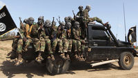 Members of al Shabaab ride in a pick-up truck outside Somalia's capital Mogadishu (Reuters)