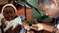 Doctor giving infant a vaccine (Reuters)