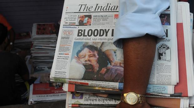 An Indian newspaper reports news of Gaddafi's death. (Getty)