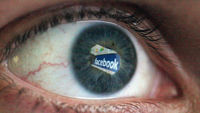 A Facebook user watches a monitor (Getty)