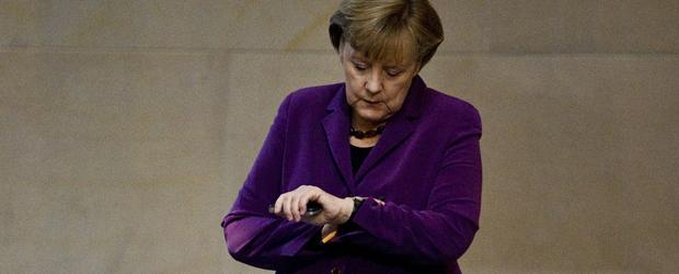 Eurozone: German Chancellor Angela Merkel checks her watch. (Getty)