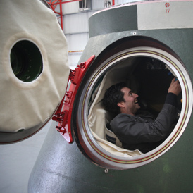 Al Thomson trying out the Russian space capsule (Morland Sanders)