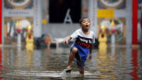 A Thai boy plays in Bangkok (Reuters)