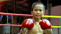 In Thailand, children as young a five earn cash by taking part in a version of boxing which uses elbows, knees and feet as well as fists. But medical experts say it is dangerous and want it banned.