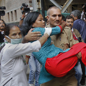 Woman injured and 10 people killed after Delhi bomb blast (Reuters)