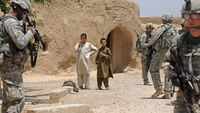 9/11 ten years on: US soldiers in a village in Afghanistan. (Getty)