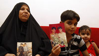 Baha Mousa's mother and son. The inquiry into his death while in the custody of the British Army was published today (Reuters)