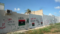On a roundabout in central Tripoli, a wall of revolutionary graffiti that looks designed for a Hollywood set. (Jonathan Miller)