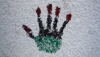 A handprint on a wall in central Tripoli:  to me this just said