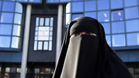 Hind Ahmas wears a niqab, despite a nationwide ban on the Islamic face veil, outside the courts in Meaux (Reuters)