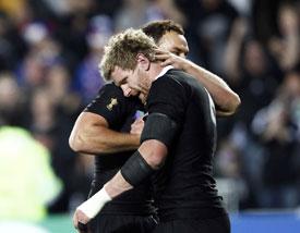 New Zealand All Blacks' Adam Thomson celebrates with Israel Dagg