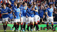 Lee Wallace of Rangers celebrates with team-mates after scoring his team's third goal during the Clydesdale Bank Scottish Premier League match between Rangers and Celtic (Getty)