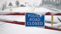 A police road closed sign is displayed on the snow gates of the A93 road on April 3, 2012 in the Spittal of Glenshee, Scotland (Getty)