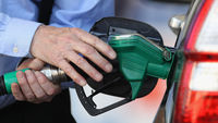 Members of the public buy fuel at a petrol station on March 29, 2012 in Linlithgow, Scotland (Getty)
