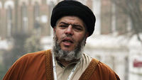 Radical Muslim Cleric Abu Hamza conducts a service of Friday afternoon prayers outside the Finsbury Park Mosque March 28, 2003 in London (Getty)