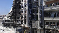 A general view of buildings, which according to the opposition were damaged by the government's army, at Juret al-Shayah in Homs (Reuters)