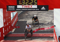 David Weir's superb win was his sixth wheelchair title, matching the London record. Weir won by a second from Switzerland's Marcel Hug in one hour thirty-two minutes 26 seconds.
