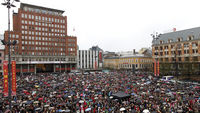Up to 40,000 people staged an emotionally-charged sing-along in Oslo near the court house (Reuters)