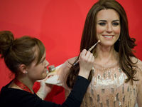 An employee poses putting finishing touches to a new waxwork statue of Britain's Catherine, Duchess of Cambridge as it is unveiled at Madame Tussauds (Getty).