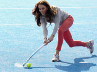 Britain's Catherine, Duchess of Cambridge hits the ball as she plays with members of the British hockey team at the Riverside Arena during a visit to the Olympic Park in London (Getty).