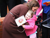 Catherine, Duchess of Cambridge hugs a young girl as she visits Alder Hey Children's NHS Foundation Trust on February 14, 2012 in Liverpool, England (Getty).