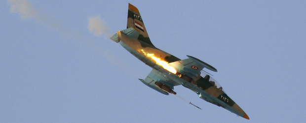 A Syrian air force jet made at least a dozen rounds of a village not far from Aleppo, Syria's most populous city, firing missiles from the sky and terrifying inhabitants.