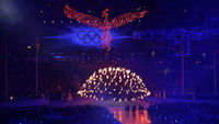 A neon phoenix rises above the flames of the dying Olympic cauldron at the closing ceremony of the London 2012 games (Reuters)