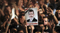 Thousands of Egyptians gather in Tahrir Square to support President Mohamed Morsi's decision to replace his defence minister and army chief while ordering several senior generals to retire.