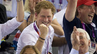 Prince Harry attended a number of Olympic events, including track cycling, where he sat with Sir John Major and his cousin, Peter Phillips