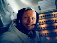 Armstrong was all smiles when he returned to the lunar module after his moonwalk (pic: Reuters)
