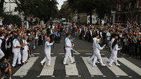 The torchbearers recreate the Beatles pose in Abbey Road (pic: Reuters)
