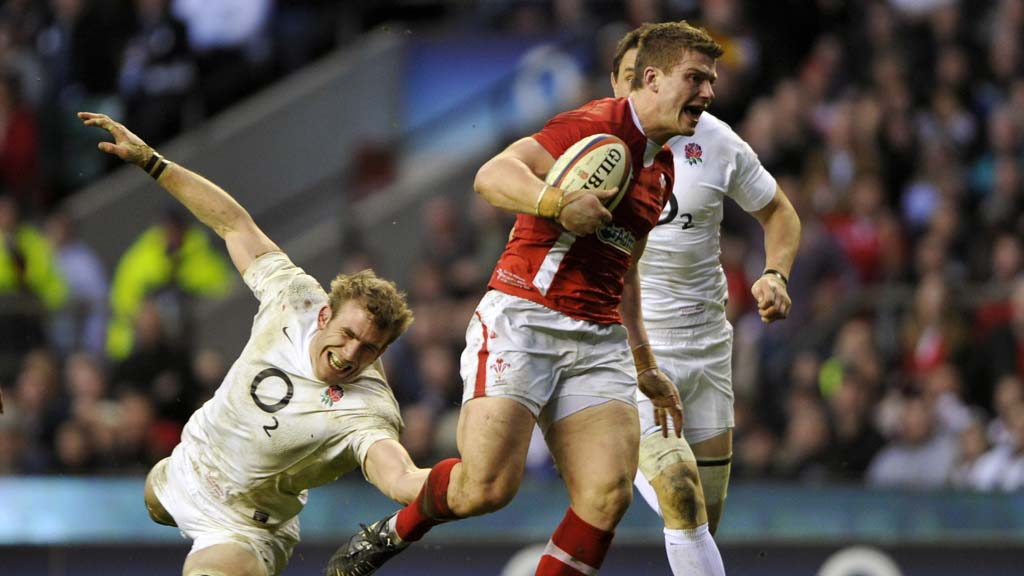 Wales' Williams evades a tackle from England's Croft to score a try against England during their international Six Nations rugby match at Twickenham in London (Reuters)