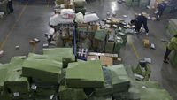 Delivery company prepares online shopping (Reuters)