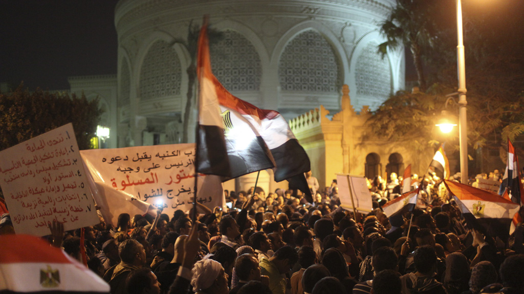 Crowds of protestors outside Egypt's presidential palace (Reuters)
