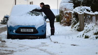 A woman clears her car from snow in Banockburn on December 3, 2012 in Banockburn, Scotland (Getty)